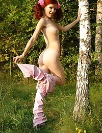 Red-haired youthful in a forest
