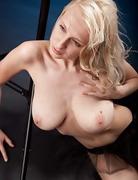 Blonde at one's disposal the photo shoot showcases her enormous tatas